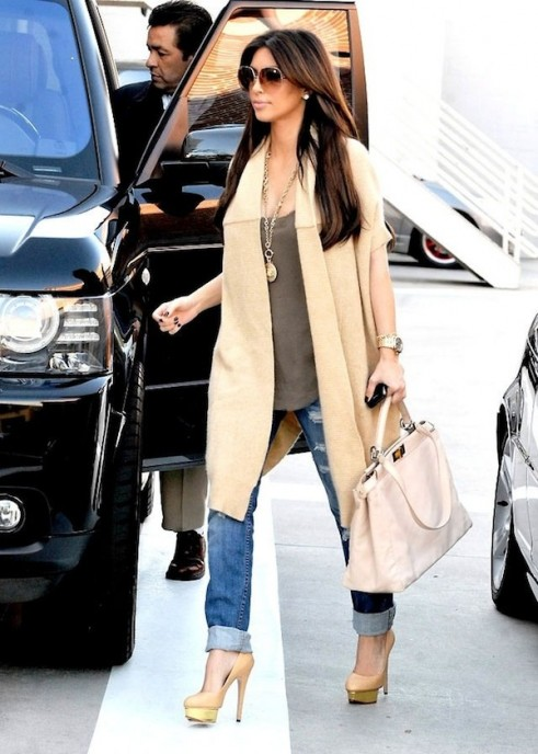 Kim Kardashian Rocks a Gucci Pantsuit Without a Top in L.A. Kim wore this form-fitting white dress and a lip ring. bandeau, and moto-detail puffer jacket that coordinates with his casual.