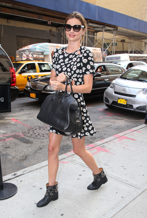 Miranda Kerr spotted out and about, wearing a black dress with small white flowers in New York City